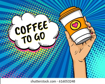 Pop art background with female hand holding bright travel coffee mug and speech bubble with Coffee to go text. Vector colorful hand drawn illustration in retro comic style.