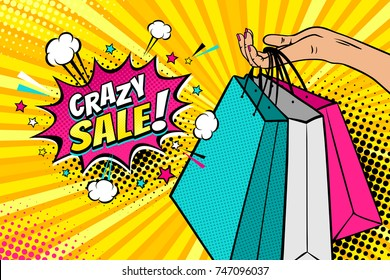 Pop art background with female hand holding bright shopping bags and Crazy sale speech bubble with stars, clouds and halftone. Vector colorful hand drawn illustration in retro comic style.