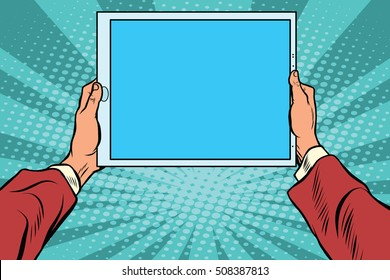 Pop art electronic tablet in the hands, retro vector. Modern gadgets