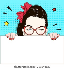 Pop Art Vintage advertising poster comic girl in cat-yey glasses winks and holds a white banner . Comic woman with speech bubble. Vector illustration