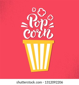 Pop corn lettring sign with striped bucket of popcorn. Hand dwawn brushpen calligraphy on bright red background