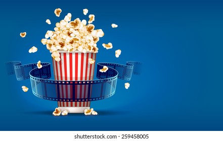 Popcorn for cinema and movie film tape on blue background. Eps10 vector illustration
