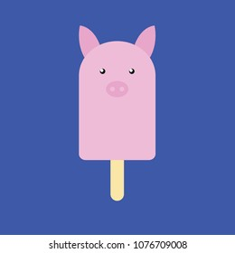 Popsicle in the shape of a Pig on dark blue