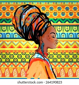 Portrait of beautiful African woman with earring (profile view) over ethnic style pattern