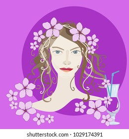 Portrait of a brunette girl with pink flowers and a red cocktail on a pink background