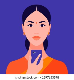 Portrait of an Indian girl holding a mobile phone in her hand. Avatar female. Addiction on the Internet and social networks. Vector Flat Illustration