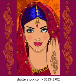 Portrait of an Indian woman with mehndi and paisley.  Indian shaadi