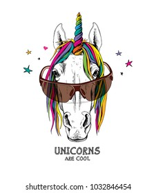 Portrait of a magical unicorn with a bright mane and horn, in a glasses on a starry background. Vector illustration.