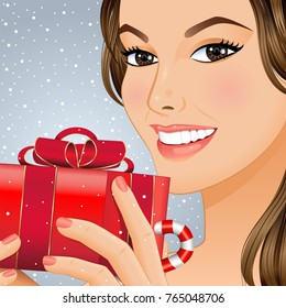 Portrait a smiling girl with gift box in her hands. Vector illustration.