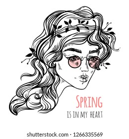 """Portrait of a young beautiful woman in pink sunglasses with lettering """"Spring is in my heart"""". Line art vector illustration. Isolated on white. Sketch style"""