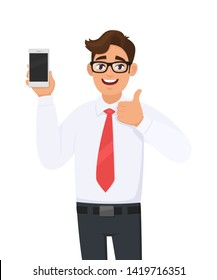 Positive business man showing new brand, latest smartphone. Man holding cell, mobile phone in hand and gesturing/making thumbs up sign. Good, like, agree, approve, modern lifestyle, digital technology