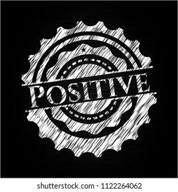Positive chalk emblem written on a blackboard