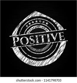 Positive chalkboard emblem on black board