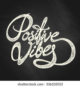 Positive Vibes- hand drawn quote, white on the blackboard background