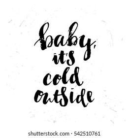 poster with a handwritten inscription. Brush Calligraphy baby it's cold outside