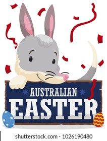 Poster with happy bilby holding a wooden greeting sign with decorated eggs and under a confetti shower to celebrate the Australian Easter.