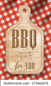 Poster with meat cutting loft wood board lettering BBQ for you on a red checkered tablecloth.