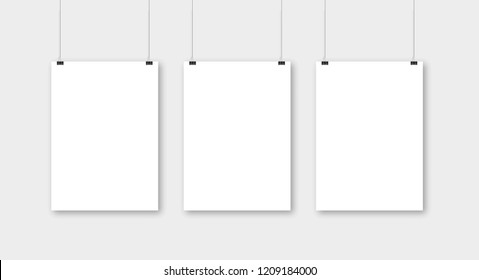 Poster template of a paper sheet. Hanging posters Set.