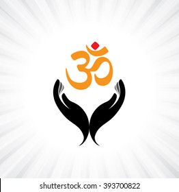 praying person's hand and om symbol - concept of a devout hindu worshiping or meditating shiva, vishnu or other indian god
