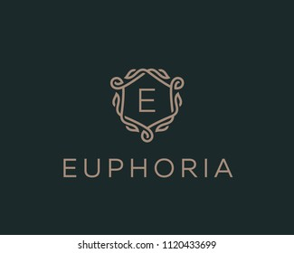 Premium linear shield monogram letter E logotype. Elegant crest leaf stamp icon vector logo. Luxury alphabet frame symbol.
