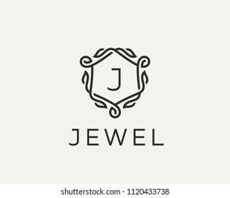Premium linear shield monogram letter J logotype. Elegant crest leaf stamp icon vector logo. Luxury alphabet frame symbol.