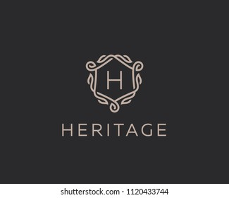 Premium linear shield monogram letter H logotype. Elegant crest leaf stamp icon vector logo. Luxury alphabet frame symbol.