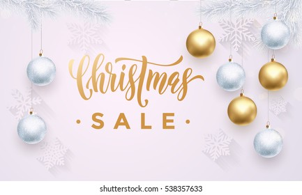 Premium luxury Christmas Sale background for holiday promo card. Golden decoration ornament with Christmas ball on vip white background with snowflake pattern. Gold calligraphy lettering