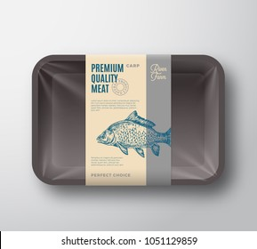 Premium Quality Carp. Abstract Vector Fish Plastic Tray with Cellophane Cover Packaging Design Label. Modern Typography and Hand Drawn Carp Silhouette Background Layout. Isolated.