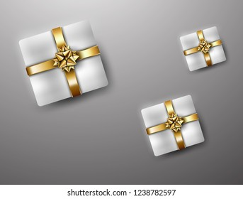 Present box with golden ribbon
