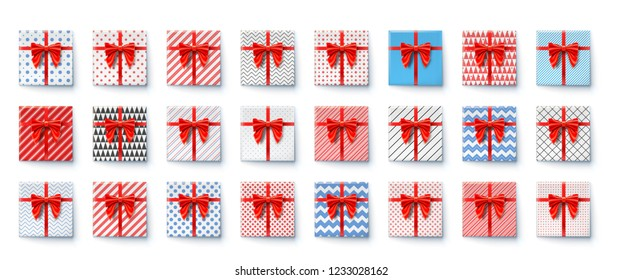 Present boxes with red ribbon and big bow isolated on white. Festive packaging for New Years, Christmas, birthdays holidays. Top view on gift boxes wrapped in paper of various colors with patterns.