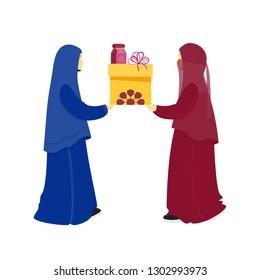 Present. Muslim sisters give a gift to each other. Prophet Mohammad Sunnah to give gifts. Birthday, anniversary, wedding, Ramadan, Eid al-Adha, Eid al-Fitr, Islamic holidays. Hijab, niqab, abaya.1