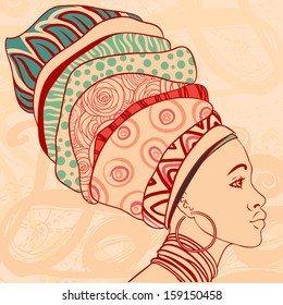 Pretty African American Girl in traditional turban. Profile view.