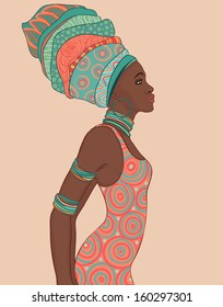 Pretty African American woman in traditional turban. Profile view