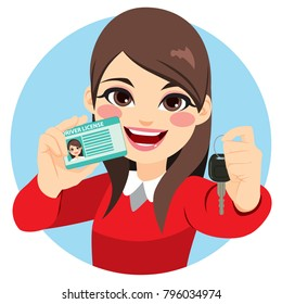 Pretty brunette woman happy smiling showing her new driver license and car keys