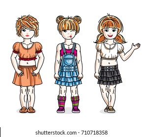 Pretty little girls standing wearing casual clothes. Vector set of beautiful kids illustrations.