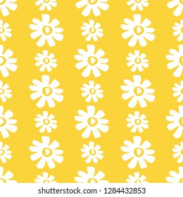 Pretty pop art retro seamless pattern of stylized daisies on a yellow background. Vertical stripes, 1960's flower power design for textiles, stationery, party invitations, home decor and design.
