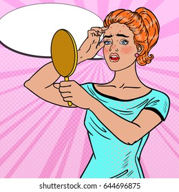 Pretty Teenager Girl Looking in the Mirror on her Pimple. Skin Care. Pop Art Vector illustration