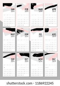 Printable 2019 calendar template. Abstract design with textured brush strokes in black, gray and pastel pink. Minimalist and modern twelve month calendar design.