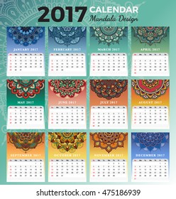 Printable monthly calendar 2017 design with colors of seasons and henna tattoo. 2017 Desk calendar template start with Sunday and support for 8.5x11 inches. Vector illustration