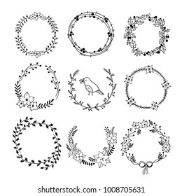 PrintHand drawn wreaths graphic set. Round vector floral wreaths for card and invitation design