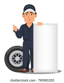 Professional auto mechanic in uniform. Smiling cartoon character standing near blank placard and car wheel. Expert service worker. Vector illustration