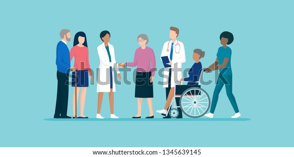 Professional caregivers and doctors meeting and supporting senior citizens and their families, senior care and medical assistance concept