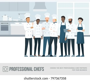Professional chefs standing together in the restaurant's kitchen