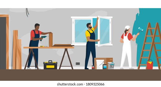 Professional contractors working on a home renovation, construction, windows installation and painting