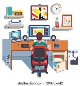 Professional designer working on a site project at his big desk with laptop computer and big display accompanied by   Flat style color modern vector illustration.