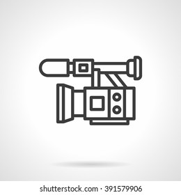 Professional equipment for filming and video. Camera with microphone. Film industry, movie, cinema. Black line style single vector icon. Element for web design, business, mobile app.