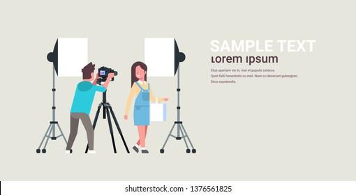 professional man photographer using dslr camera on tripod shooting beautiful woman model girl posing modern photo studio horizontal full length copy space