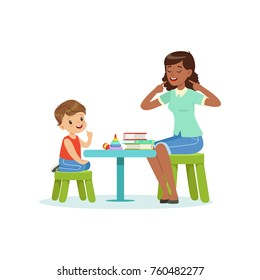 Professional speech therapy for preschool kid with therapist in kindergarten. Isolated flat vector