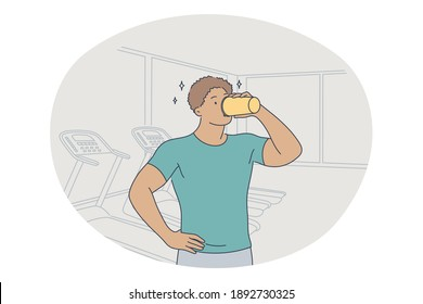 Professional sport, workout, training concept. Young man athlete standing and drinking water after training in gym and feeling energetic. Active lifestyle, fitness, bodycare, wellness