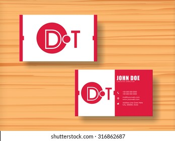 Professional stylish horizontal business card, name card or visiting card set in pink and white colors on wooden background